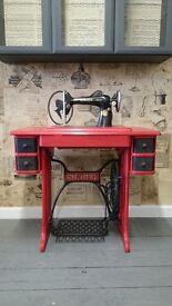 Vintage/shabby chic beautiful, old Singer sewing machine in red and black.