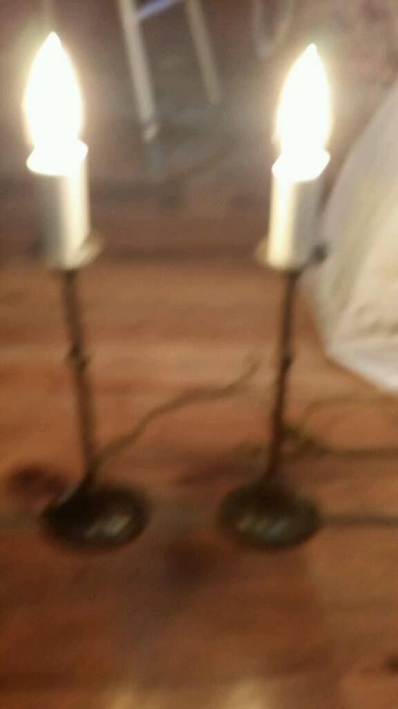 Two bronze Laura Ashley lamps with antique bulbs