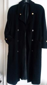 M&S black woollen ladies coat. Mid length. Brass buttons. Very good condition.