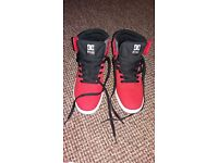 DC men's trainers new never worn. Red and black size 8.5.