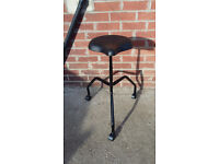 tailors chair with bike seat and on wheels