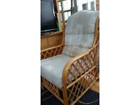A pair of wicker conservatory chairs for sale