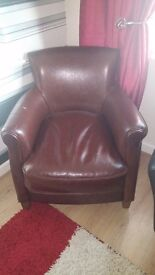Brown leather chair from creations. 1 year old .