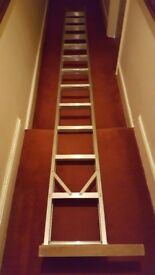 Aluminium loft ladder. 11 feet tall. In good condition.