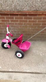 Kettler pink toddler tricycle with parents pole