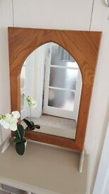 Arched mirror in a Solid Oak frame......Good condition