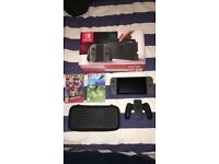 Nintendo switch console with Mario odyssey / Zelda breath of the wild and carry case