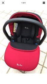 Silvercross chilli red car seat and isofix base.