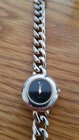 Delicate quartz watch with a chunky bracelet