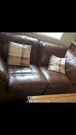 Tan DFS two seater leather sofa