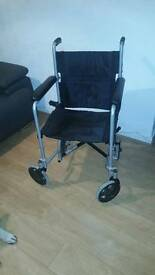 Wheelchair and crutches for sale.