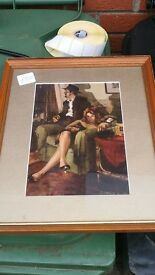 Vintage Picture. Framed couple on chair. Old