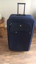 Large navy suitcase