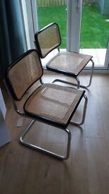 four dining chairs, black with wicker seat and backs