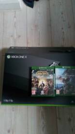 Xbox one x 1tb with far cry5 & monster hunter