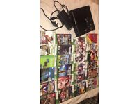 Xbox 360 (2014) good condition 2 controllers all mains cables 24 various games
