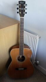 Hardly touched beautiful Cort acoustic guitar - with bag and accessories - like new!