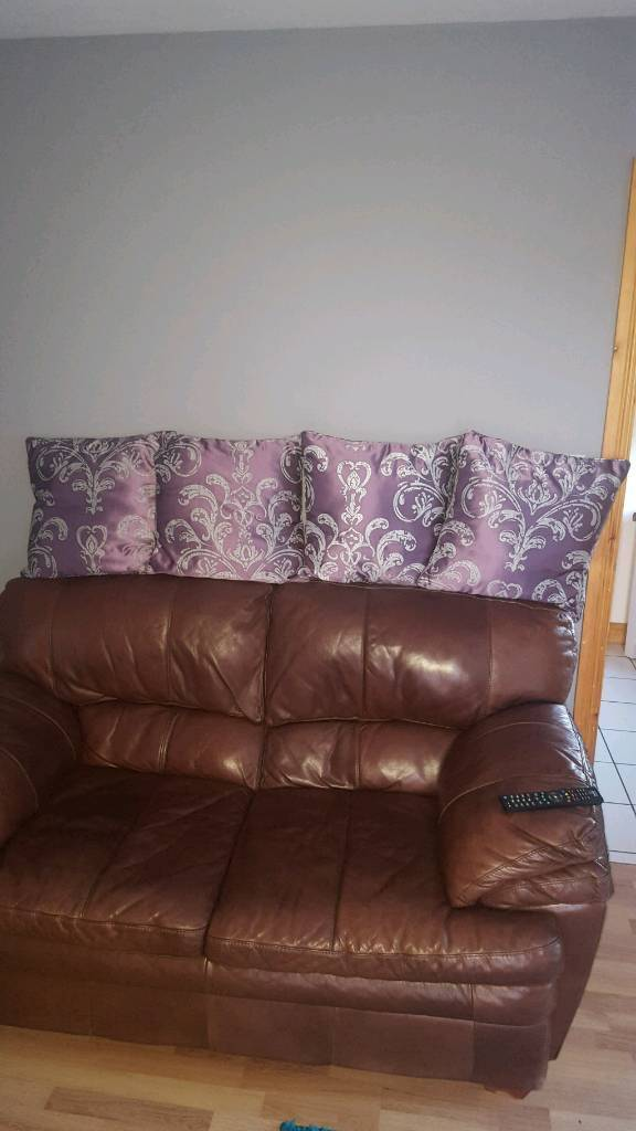 4 Purple and silver cushions