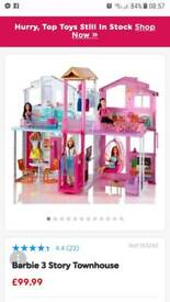 The Barbie 3-Story Townhouse with dolls