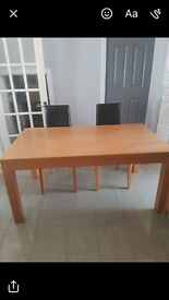 Large solid oak dinning table and 4 black leather chairs