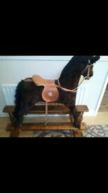 Beautiful mamas and papas rocking horse, solid wood base stands over 4 ft tall. Excellent condition.