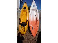 Pair Sit on Kayaks