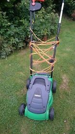 Powerbase electric lawnmower, hardly used.