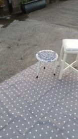 Small white round mosaic table with sputnic feet