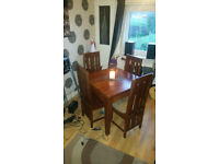 Stunning Solid wood Dining Table an Chairs