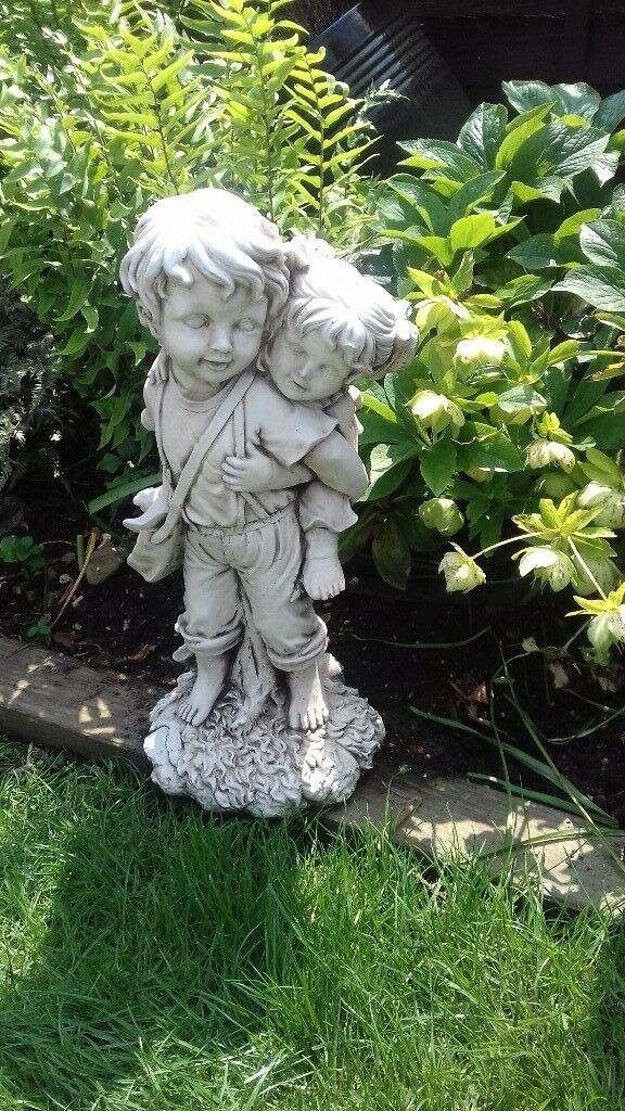 2 Garden Statues. A Boy Piggybacking A Girl And A Cute Dog.