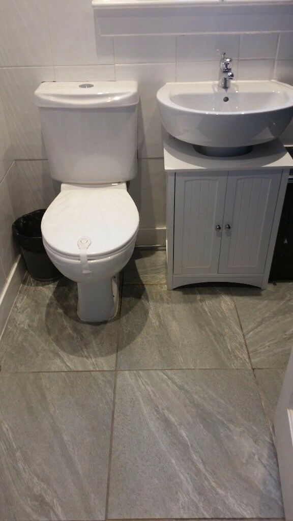 Toilet And Sink With Tap And Cabinet