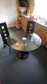 Glass kitchen dinner table with marble bottom