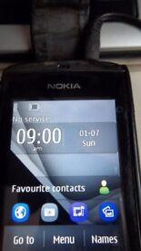 2no nokia asha 300 mobile phones