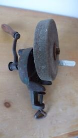 For collectors of antique / vintage tools: a rotary, hand-cranked, sharpening / grinding stone.
