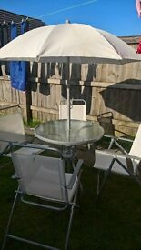garden table chairs amd parasol