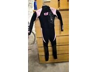 girls full length wet suit, suit age 7-8. creative solutions. great condition. back zip with pull.