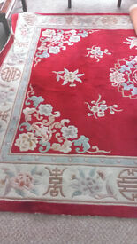 Large Rug. Chinese pattern in dark red.