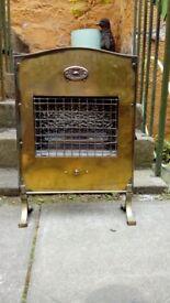 Vintage brass electric fire
