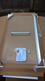 NEW & UNUSED glass shower screen with towel rail. In original packaging.