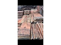 Approximately 12-1400 roof tiles.A mixture of makes but all blend together and came off one roof.