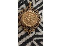 9 carrot gold St. George's pendant