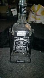 empty 3 liter jack daniels bottle with cradle