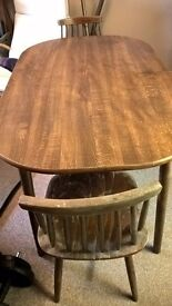 nice wooden table with two chairs