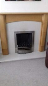 Gas fire and marble hearth wood surround.