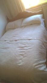 Double bed with headboard.