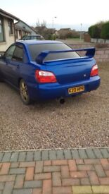 New age Subaru Impreza saloon high level spoiler