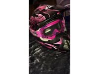 THH pink motocross / dirt bike helmet with Oakley goggles