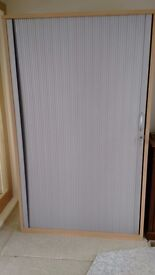Large tambour cupboard in light beech, like new, four shelves