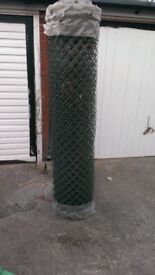 Roll of green plastic coated metal chainlink fencing