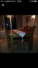Dining chairs. 4 x tan coloured faux leather